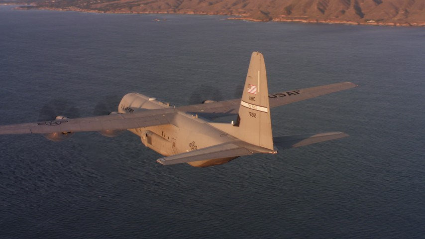 4K stock footage aerial video of flying around a Lockheed Martin C-130J near the coast of Northern California at sunset Aerial Stock Footage WAAF06_C059_0119W4_S000 | Axiom Images