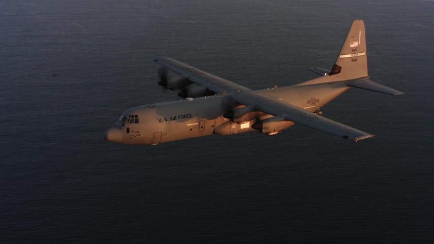 4K stock footage aerial video of a Lockheed Martin C-130J flying over the ocean at sunset, Northern California Aerial Stock Footage | WAAF06_C067_011987