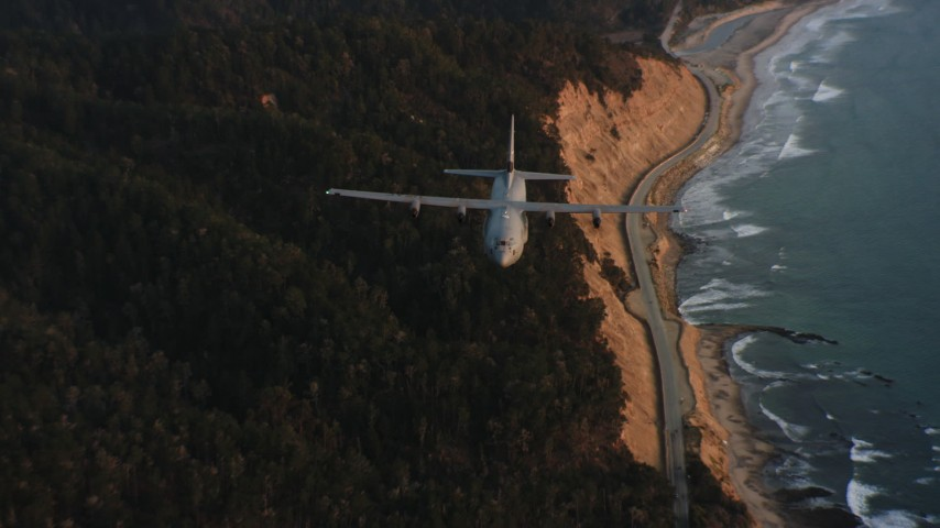 4K stock footage aerial video of a Lockheed Martin C-130J following the coast at sunset in Northern California Aerial Stock Footage | WAAF06_C072_01194X