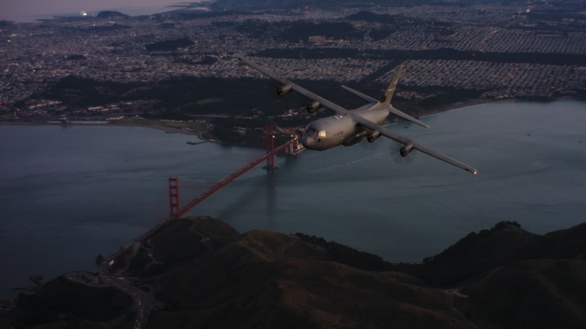 4K stock footage aerial video of a Lockheed Martin C-130J flying over the Marin Hills at sunset near San Francisco, California Aerial Stock Footage | WAAF06_C085_0119X1_S000