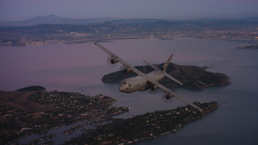 4K stock footage aerial video of a Lockheed Martin C-130J over Richardson Bay at sunset in Northern California Aerial Stock Footage WAAF06_C085_0119X1_S001 | Axiom Images