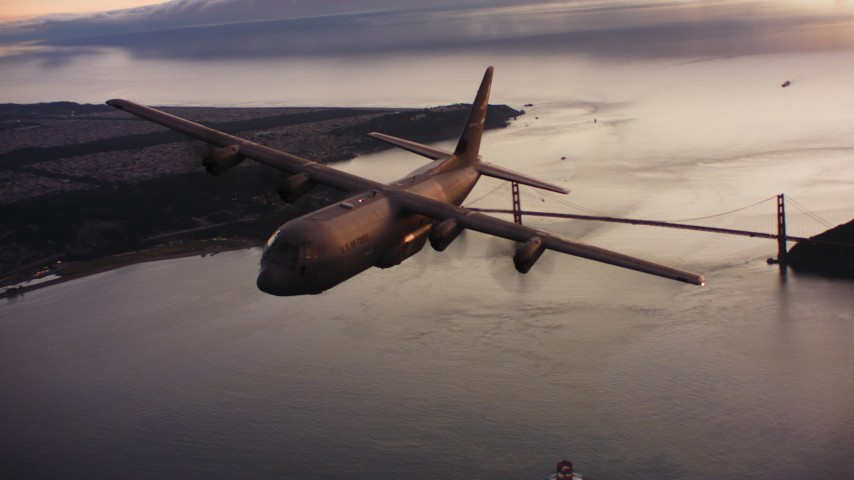 4K stock footage aerial video of a Lockheed Martin C-130J flying over the Golden Gate Bridge at sunset, California Aerial Stock Footage | WAAF06_C087_0119KX