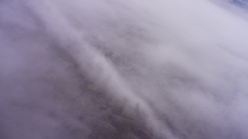 4K stock footage aerial video of a reverse view of misty clouds in Northern California Aerial Stock Footage | WAAF07_C003_0119XV