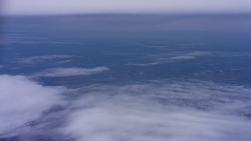 4K stock footage aerial video of patchy clouds below a tick cloud layer in Northern California Aerial Stock Footage | WAAF07_C007_0119FV