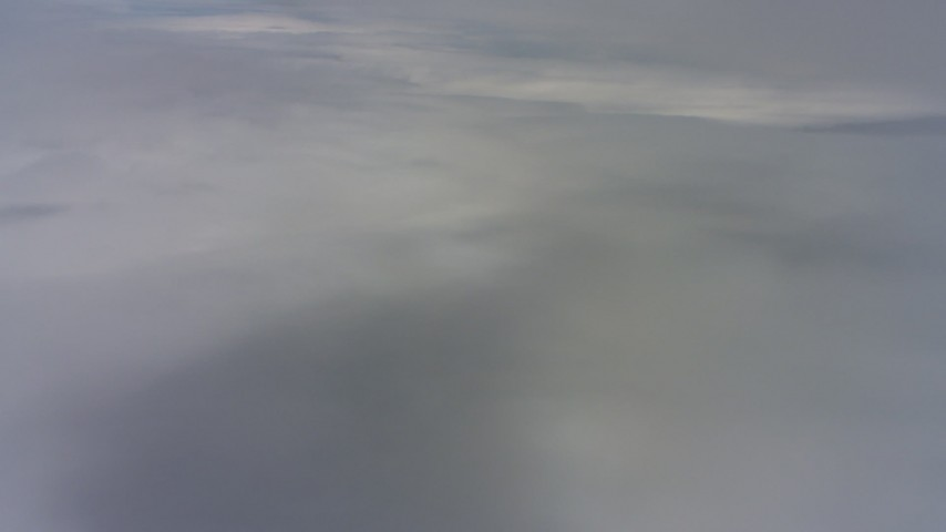 4K aerial video of a reverse view of cloud layers above Northern California  Aerial Stock Footage | WAAF07_C075_0119LB