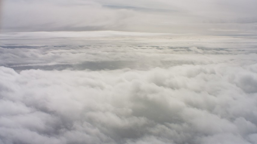 4K stock footage aerial video of flying by and descending toward a cloud layer in Northern California Aerial Stock Footage | WAAF07_C078_01193F