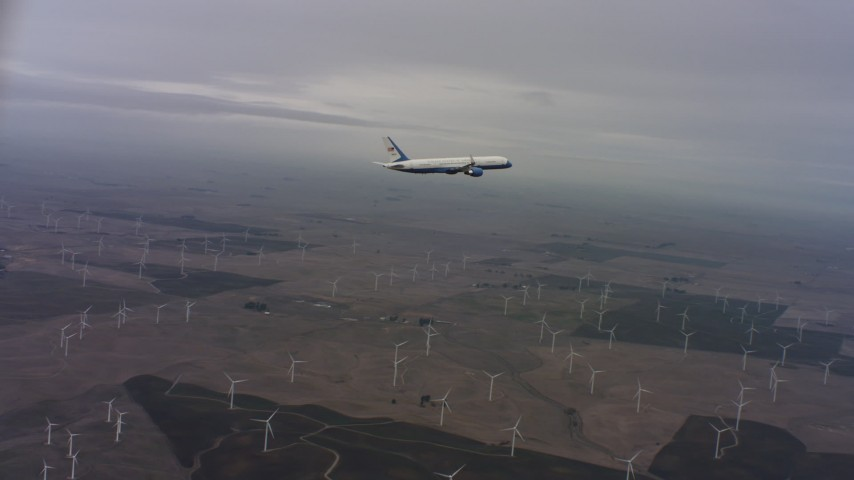 4K stock footage aerial video of tracking a Boeing C-32 over windmills in Northern California Aerial Stock Footage | WAAF08_C008_0119F0