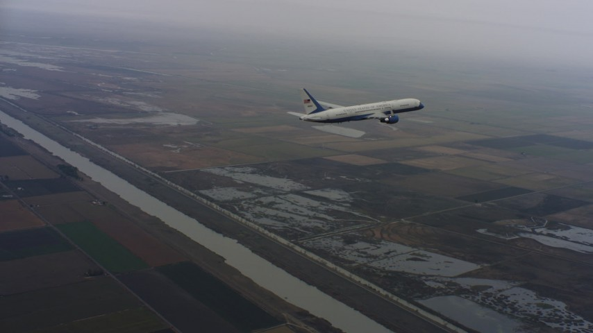 4K aerial video of a Boeing C-32 in flight over a river and farms in Northern California Aerial Stock Footage | WAAF08_C015_01193S