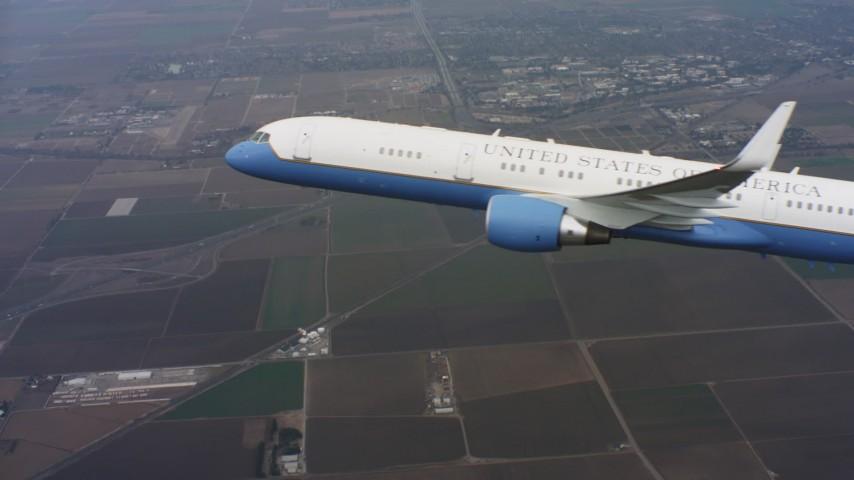 4K aerial video reveal a Boeing C-32 flying over farmland in Northern California Aerial Stock Footage | WAAF08_C018_0119DD