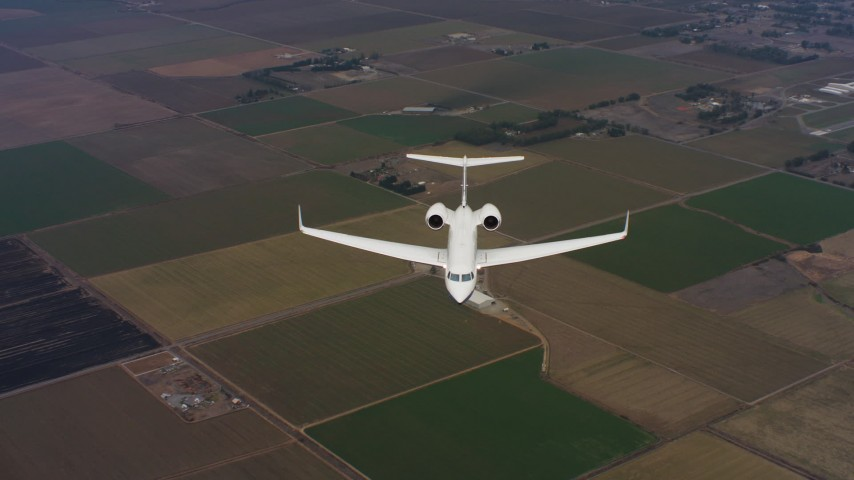 4K stock footage aerial video of a Gulfstream C-37A in flight over farms in Northern California Aerial Stock Footage   WAAF08_C044_0119CP