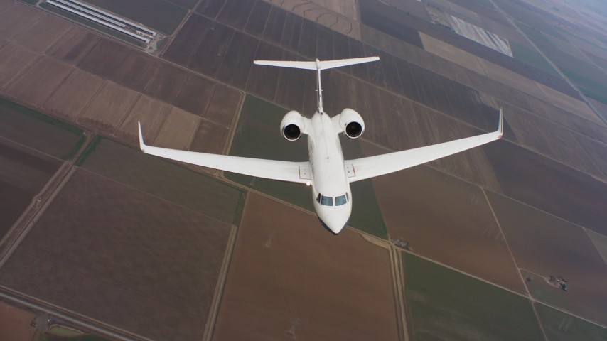 4K stock footage aerial video of a reverse view of a Gulfstream C-37A flying over farmland in Northern California Aerial Stock Footage WAAF08_C045_0120SP