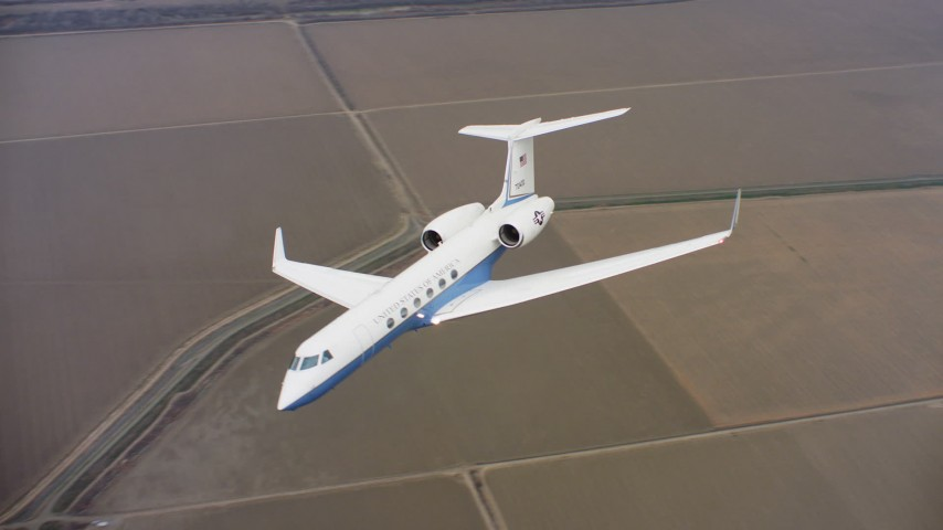 4K stock footage aerial video of a Gulfstream C-37A flying over canals and farms in Northern California Aerial Stock Footage | WAAF08_C055_0120W9