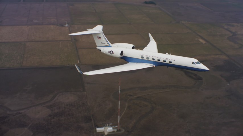 4K stock footage aerial video of flying around the nose of a Gulfstream C-37A in flight over farms in Northern California Aerial Stock Footage   WAAF08_C061_012061