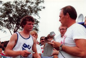 1980-07-26-Downtown-Terry Fox listens to announcer as he runs through Barrie during Ten MIlion Dollar Miracle of Hope Run across Canada (A)
