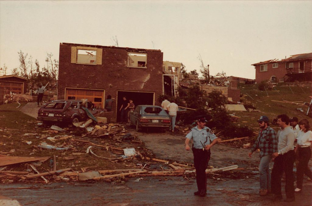 Authorities lead home owners back to their residences following the tornado.