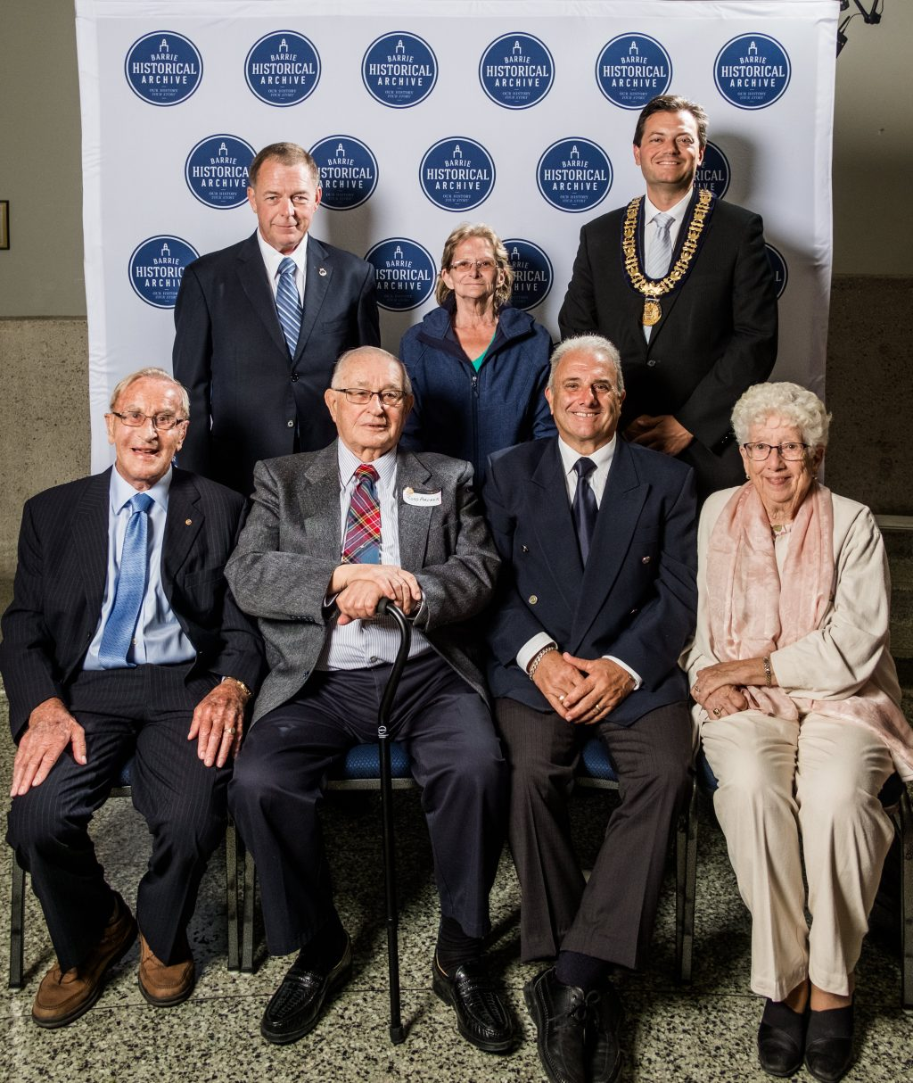 barrie 39 s former city mayors pose with a guest at the
