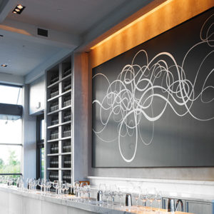 A wine tasting room featuring a large painting