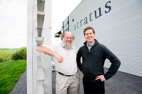 Winemaker J-L Groux stands with colleague Paul Hobbs in front of the Stratus winery sign