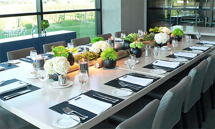 A table is set up for dining in the Mesquite Tasting Room