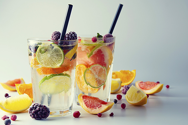 Water with various fruits in a glass