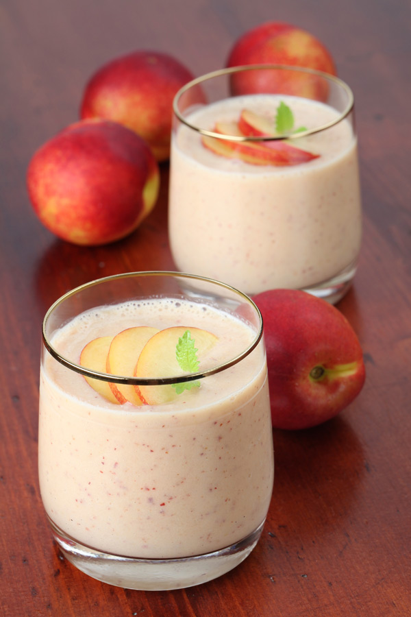 This Peaches and Cream Shakeology smoothie blends Vanilla Shakeology with diced peaches creating a satisfying sweet treat.