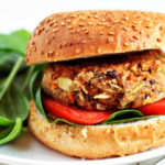 Hearty black beans and brown rice fortify these bean burgers feature fresh onion, basil, and grated Parmesan cheese for a flavorful vegetarian burger.