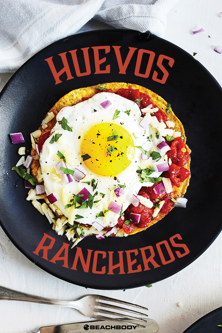 These healthier Huevos Rancheros nix the deep fried chips in favor of a single baked tortilla topped with a rich red chili sauce and a single sunny egg.