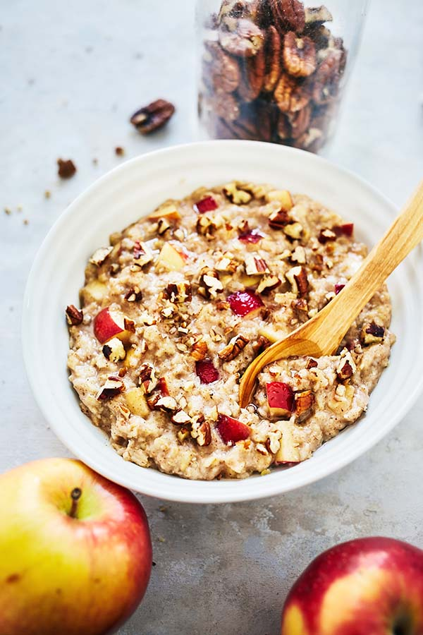 The warm flavors of this Oatmeal Recipe are an excellent way to change up your morning routine with freshly chopped apples, cinnamon, and crunchy pecans.