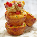 Mini Denver Quiches stacked on plate
