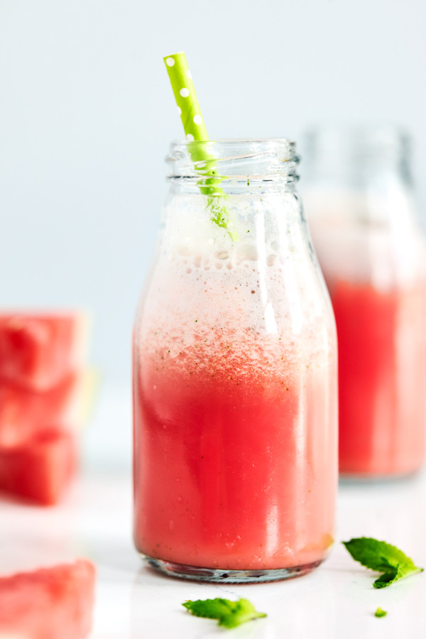 This Minty Watermelon Shakeology smoothie featuring freshly chopped mint and juicy watermelon makes a refreshing afternoon snack.