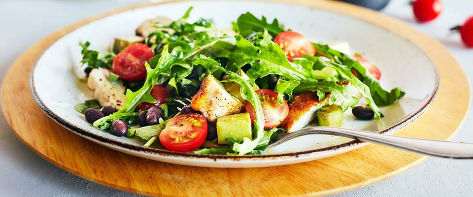 This hearty arugula salad with chicken has only 5 ingredients and can be made in minutes. Black beans, and avocado make it a satisfying lunch or dinner.