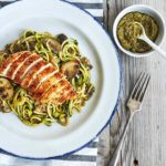 This savory Zucchini noodles recipe is topped with pesto, sautéed mushrooms, and chicken for an ultra-low in calorie, low-carb substitute for pasta.