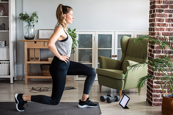 Women at home doing workout.
