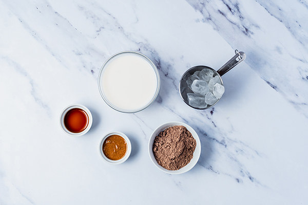 Flat lay of Maple Almond Dream Shakeology ingredients