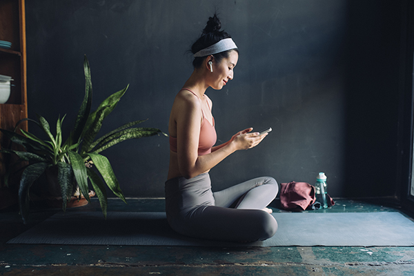 Woman doing guided meditation on her phone