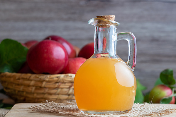 A bottle of raw unfiltered apple cider vinegar