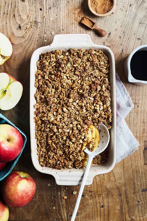 This authentic savory apple crisp dessert features the rich flavor of baked apples, walnuts, oats, and a touch of maple syrup.