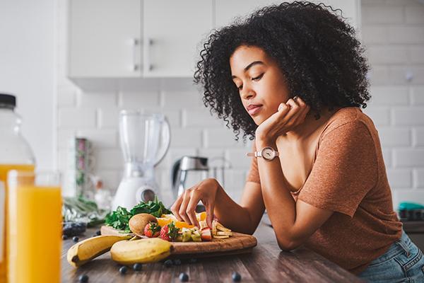 woman eating fruit