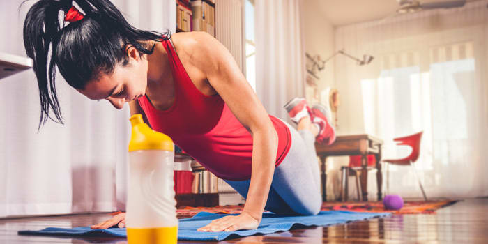 Beachbody On Demand woman working out at home