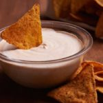 This creamy Vegan Queso Sauce doesn't contain an ounce of cheese but features nutty cashews, nutritional yeast, smoked paprika, and a hint of chili powder.