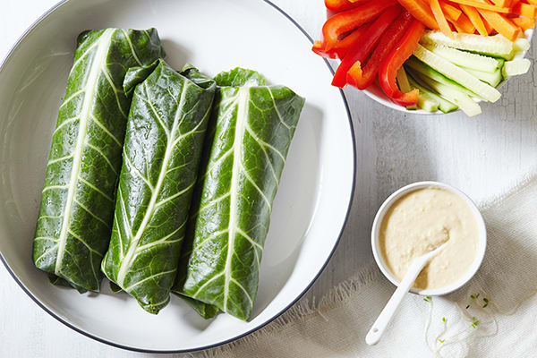 These veggie wraps made with collard greens and loaded with goodness are an easy dinner when it's too hot to cook, and they're a perfect brown bag lunch.