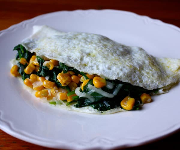 13 healthy egg recipes for every meal of the day the beachbody blog egg white omelet with spinach corn and gouda cheese breakfast recipe forumfinder Images