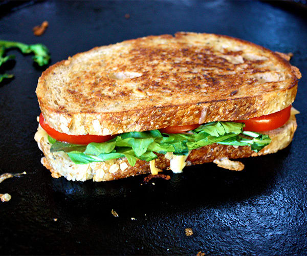 This healthier Smoked Gouda Grilled Cheese sandwich has bold roasted red peppers, creamy Dijon mustard, fresh arugula, and smoked gouda cheese.