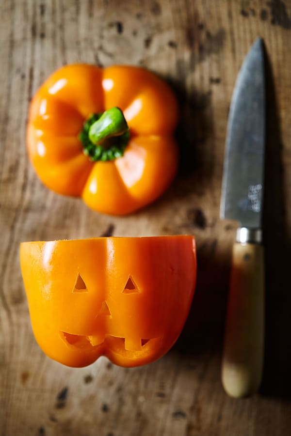 These cute little Jack-O'-Lantern Stuffed Peppers are filled with a fiesta-inspired mix of spices, ground turkey, and black beans.