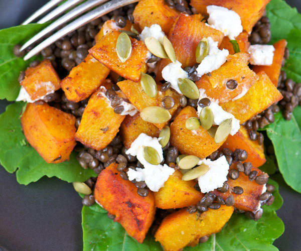 Healthy Thanksgiving recipe for roasted pumpkin salad with lentils and goat cheese.