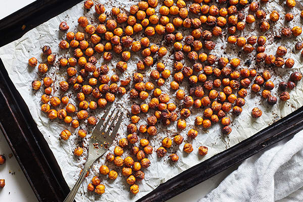 These Maple Chai Roasted Chickpeas are a cravable crunchy snack featuring savory a ginger, cardamom, and clove spice blend.