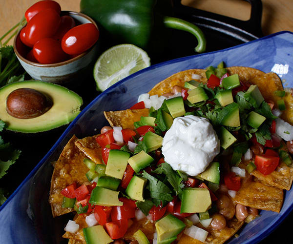 Healthy Nachos with Tomato, Avocado, and Greek Yogurt | BeachbodyBlog.com
