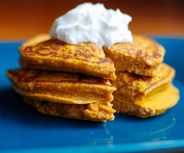 Pumpkin Protein Pancakes Topped with Greek Yogurt | BeachbodyBlog.com