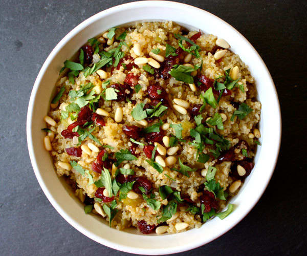 Healthy Thanksgiving recipe for quinoa stuffing with apples, cranberries, and pine nuts