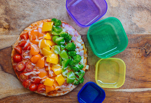 Covered in a vibrant vegetable medley of red onion, three colors of bell peppers, and broccoli florets this Rainbow Veggie Flatbread Pizza is always a hit.